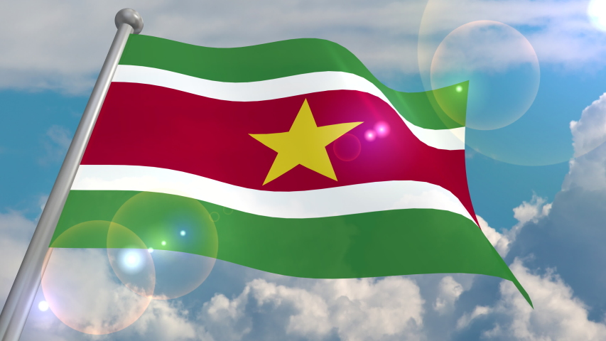 The flag of the state of Suriname is developing in the wind against a blue sky with cumulus clouds and a flash on the lens from the sun. 4K video is looped and decoded from a 3D program. | Shutterstock HD Video #1055555054