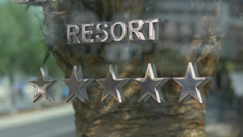 Five stars resort hotel sign in 4k slow motion 60fps | Shutterstock HD Video #1055555417
