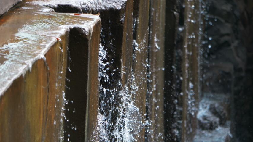 Water falling down from a stone wall in 4k slow motion 60fps  | Shutterstock HD Video #1055555471