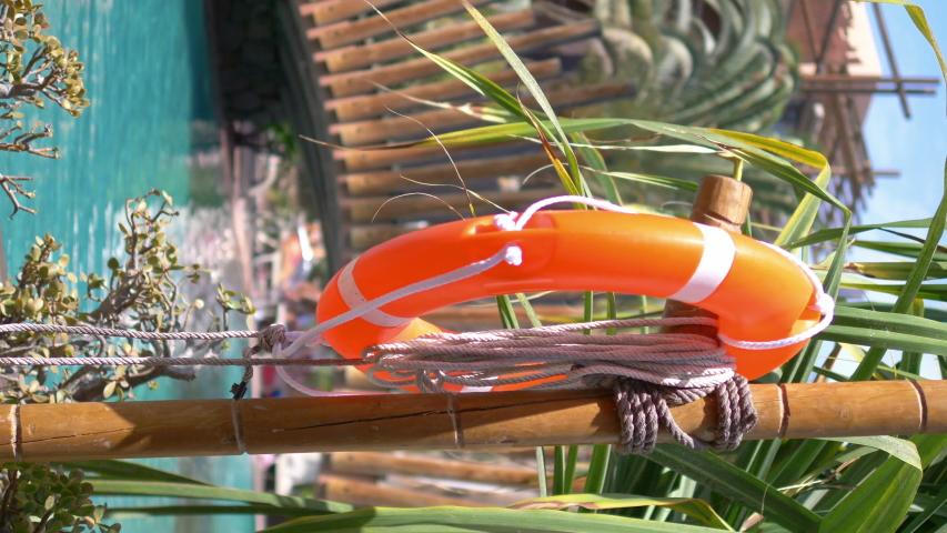 Vertical video of lifebuoy in tropical resort in 4k slow motion 60fps | Shutterstock HD Video #1055555483