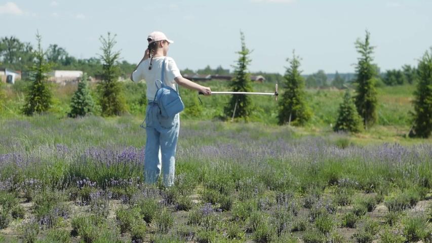 Young Teenager Girl Making Selfie At Flower Field | Shutterstock HD Video #1055555897