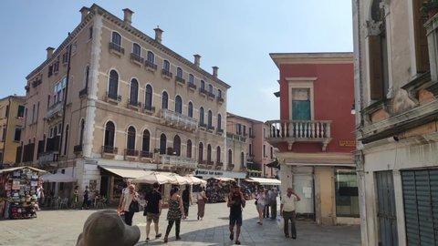 VENICE, ITALY 5 JULY 2020: People walking in Venice alley