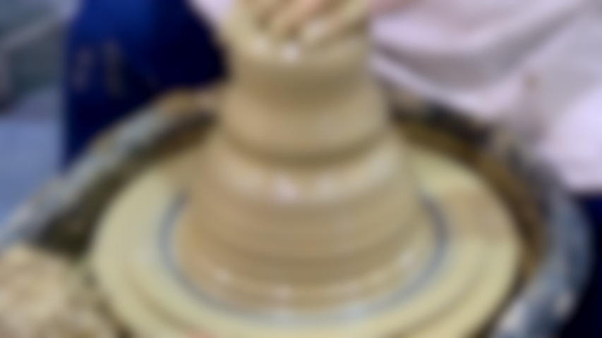 Blurred background. Fast Timelapse Workshop Molding of clay on a potter's wheel close-up. Dirty hands in the clay. Making ceramic products. Artistic creative. | Shutterstock HD Video #1055563442