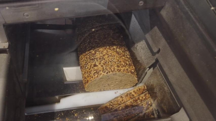 Slicing bread in cutting machine | Shutterstock HD Video #1055565821