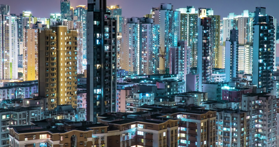 Crowded City With Lights Turning On And Off at Midnight. Night-Scape Urban Metropolis Time Lapse. Exterior of residential building public housing apartment block at night | Shutterstock HD Video #1055567948