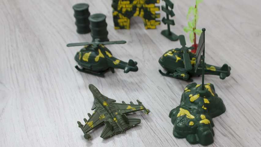 Plastic Kids toys collection on floor - military theme. | Shutterstock HD Video #1055569253