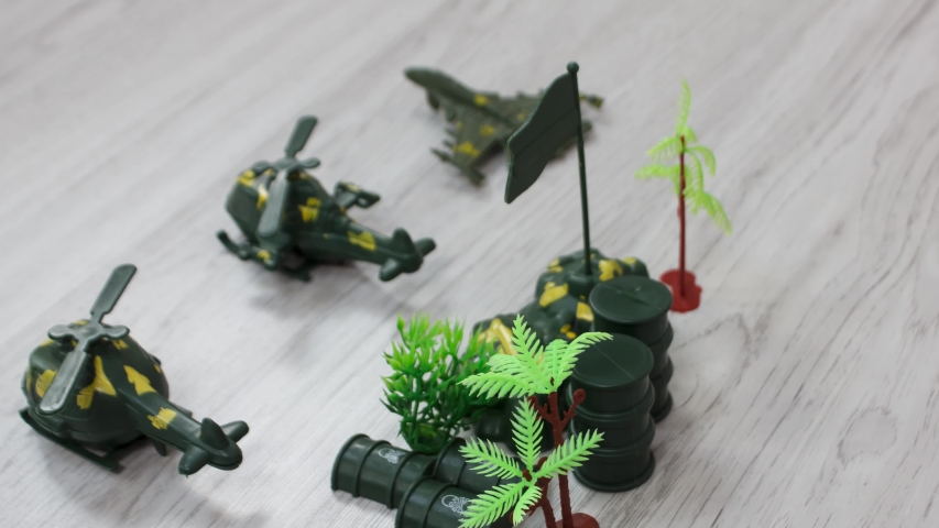 Plastic Kids toys collection on floor - military theme. | Shutterstock HD Video #1055569265