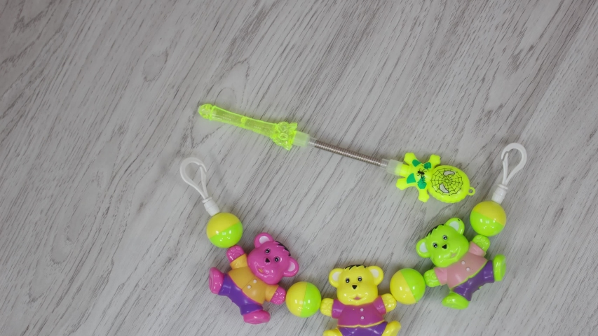 Colourful plastic Kids toys on floor. | Shutterstock HD Video #1055569274