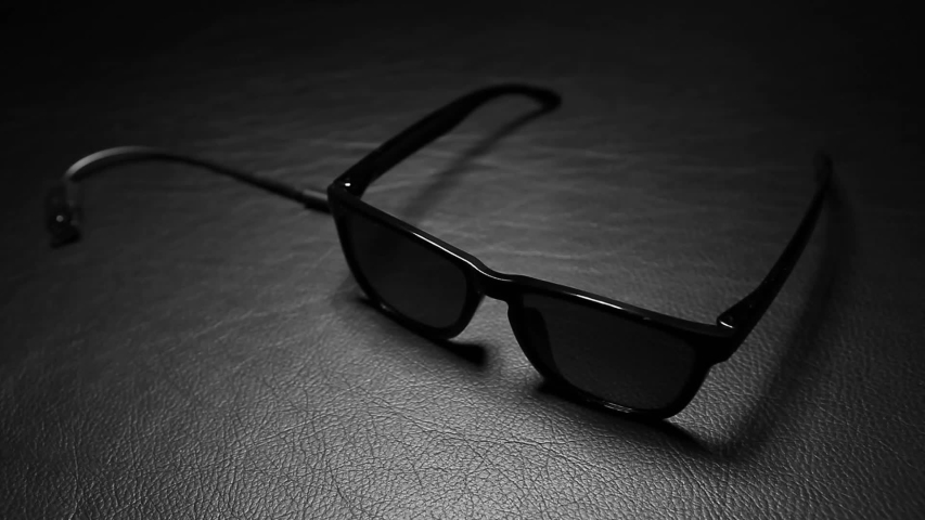 Footage of sunglasses leather background  | Shutterstock HD Video #1055574371