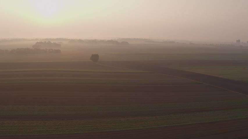 Aerial flyover the beautiful Sunrise landscape in Tuscany, Italy.   Shutterstock HD Video #1055577164