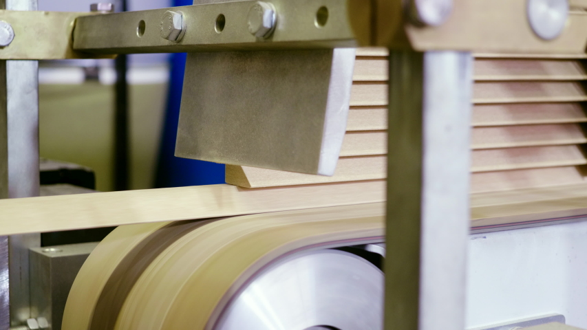 Furniture factory. Woodworking manufacturing with computerized automatic machinery. Close up of modern high-tech machine that produces furniture parts. 4K | Shutterstock HD Video #1055577314
