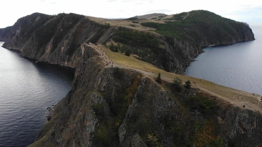 Aerial drone footage of cape Khoboy on Olkhon island, Baikal lake, Irkutsk, Russia   Shutterstock HD Video #1055578040