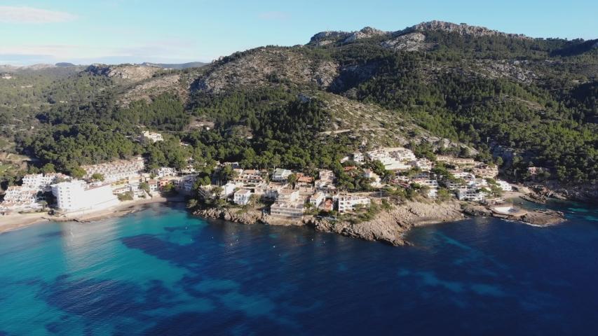 Aerial view of Mallorca island, Baleares, Spain. 4K footage of beautiful landscape, Mediterranean sea, green mountains, turquoise water, beaches, resort coastline. Sant Elm   Shutterstock HD Video #1055578967