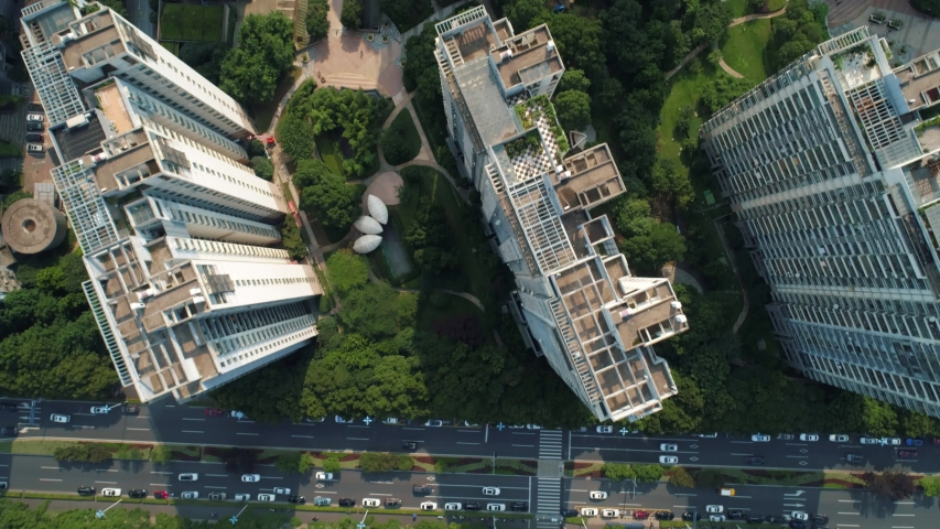 Aerial drone shot over residential apartment buildings on sunny day. Aerial shot over community apartment complex in China. | Shutterstock HD Video #1055580320