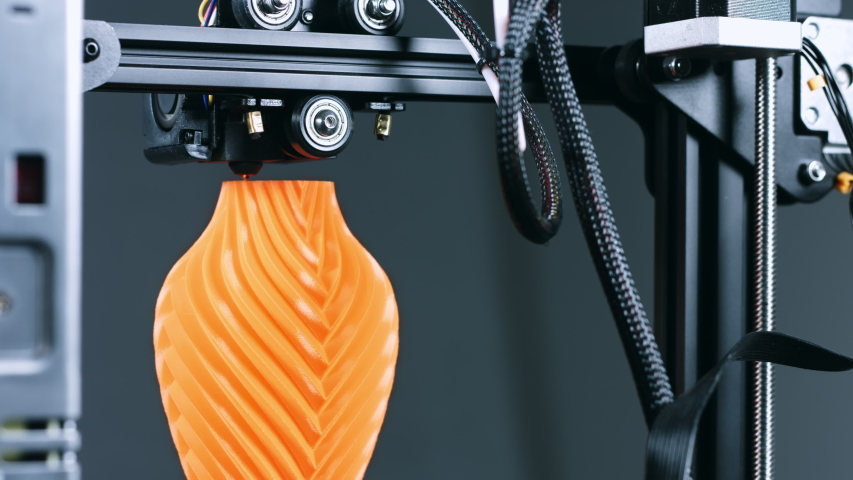 3D Printer printing a vase for home decoration with orange plastic Filament. | Shutterstock HD Video #1055591813