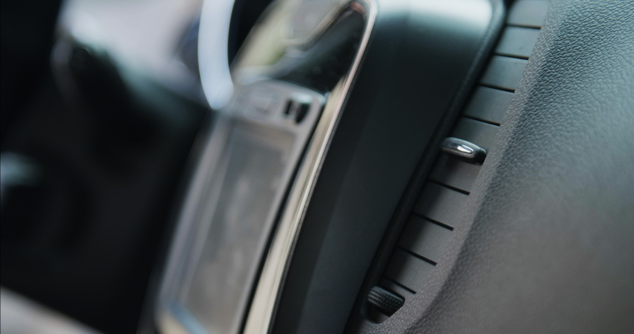 Details of the dashboard, airflow and control screen inside a new generic car | Shutterstock HD Video #1055596736