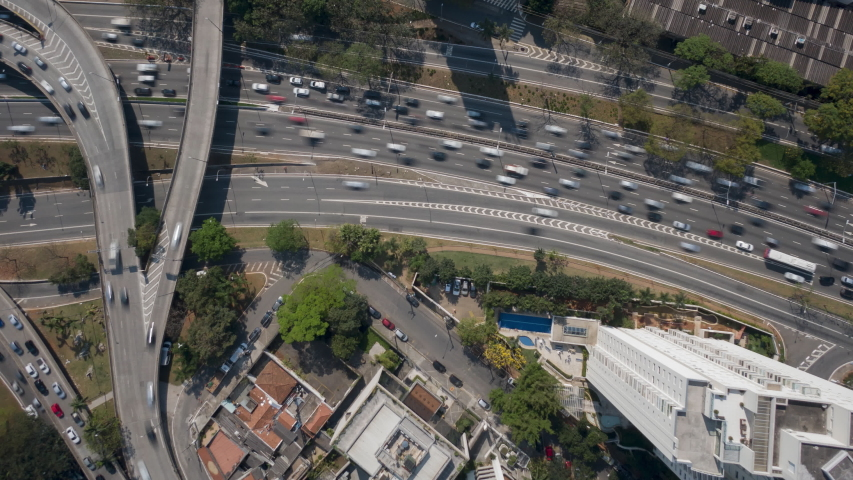 4K UHD Hyperlapse aerial drone footage of motorway 23 de maio in Sao Paulo, over Cebolinha junction, in a sunny day. Long exposure city life and transportation, concept background.