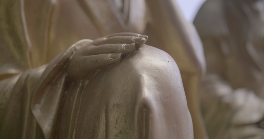 Close up of golden buddha statue hands. Ten Thousand Buddhas Monastery, Sha Tin, Hong Kong. Peaceful golden religious figure. High dynamic range footage. | Shutterstock HD Video #1055603606