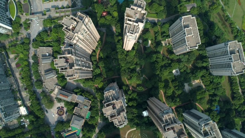 Aerial drone shot over residential apartment buildings on sunny day. Aerial shot over community apartment complex in China. | Shutterstock HD Video #1055605961