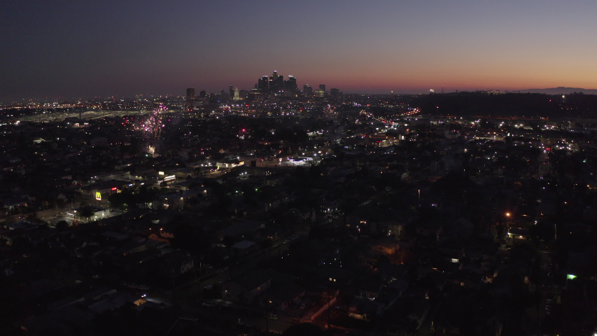 Aerial sunset view of fireworks exploding over the downtown Los Angeles, California, skyline. | Shutterstock HD Video #1055607248