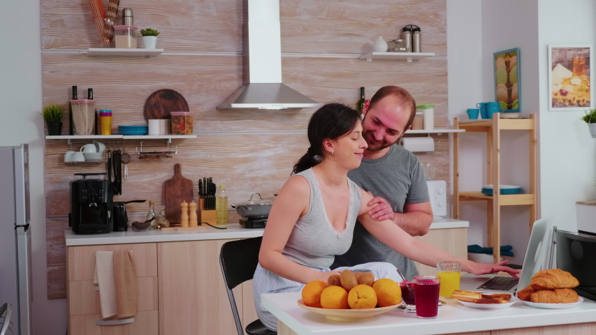 Couple doing online shopping on laptop during breakfast. Entering information, customer using e-commerce technology buying stuff on the web, cosumerism banking and ordering Royalty-Free Stock Footage #1055611283