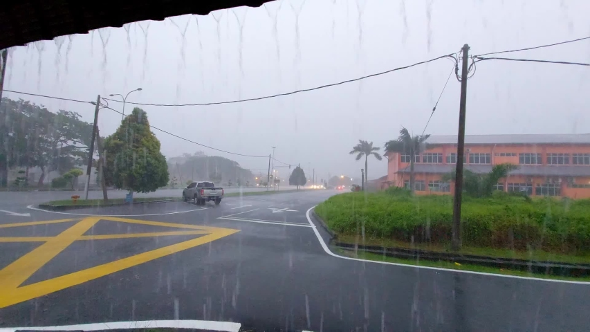 Traffic flow in monsoon season  | Shutterstock HD Video #1055618387