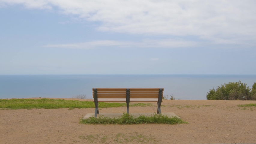 Empty Bench Overlooking the Ocean | Shutterstock HD Video #1055628749