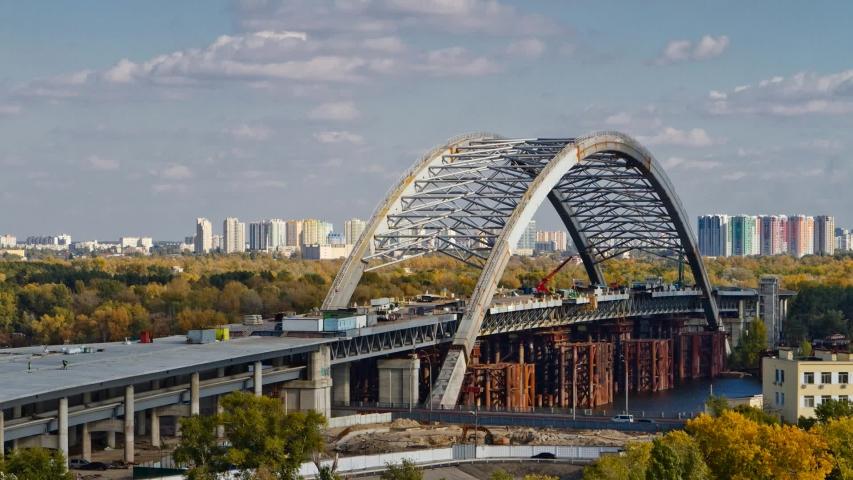 Combined car and subway bridge under construction. Unfinished Podilskiy bridge (Podilsko-Voskresenskiy bridge) | Shutterstock HD Video #1055633963