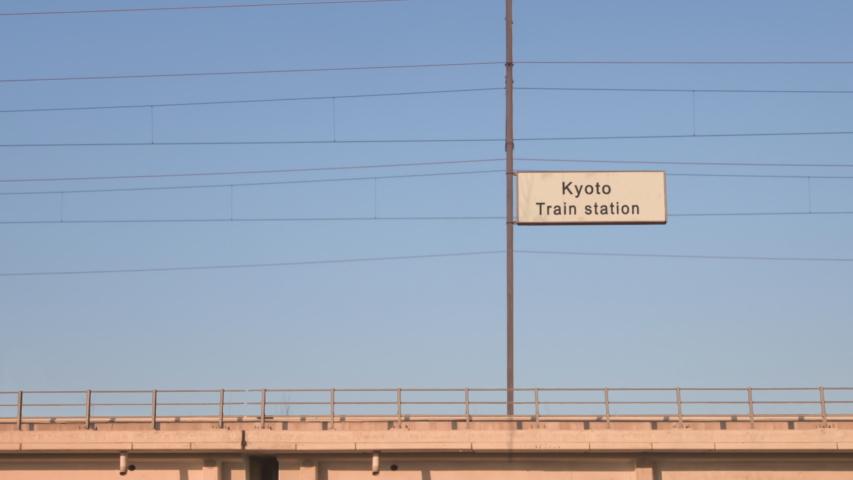 Kyoto railway sign board train goes by passing train station billboard | Shutterstock HD Video #1055650151