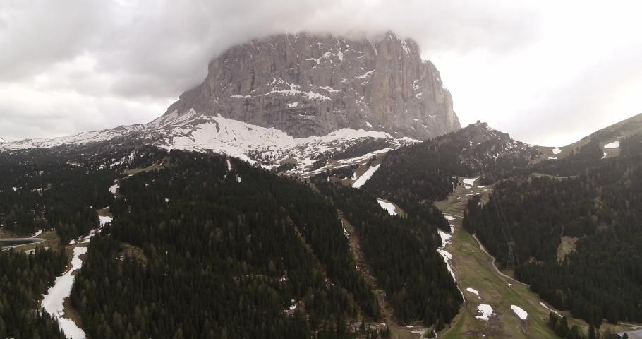 Sassolungo Aerial, peak of Langkofel hidden in the clouds. Dolomites Aerial   Shutterstock HD Video #1055651705