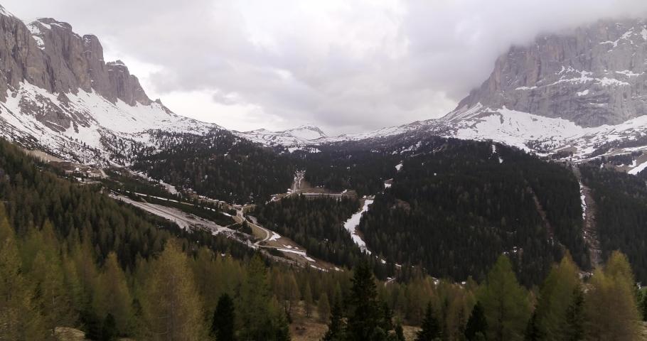 Aerial of Sassolungo in Spring, Snow Melting on Ski slopes and Ski resort   Shutterstock HD Video #1055651708