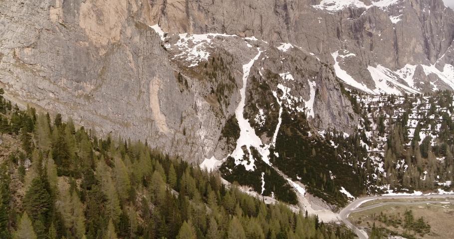 Spring Landscape in the Alps. Aerial of Dolomites in spring, snow melting 4K   Shutterstock HD Video #1055651714