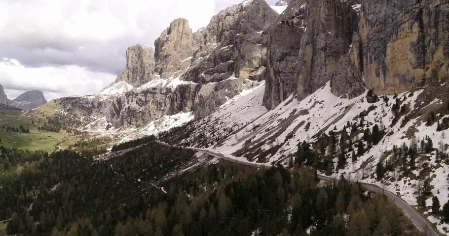 Aerial over beautiful spring landscape in the Alps. Sella mountain above Pass   Shutterstock HD Video #1055651942