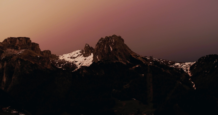 Sunset over Dolomites in Val Gardena. Aerial view of spring landscape   Shutterstock HD Video #1055651960