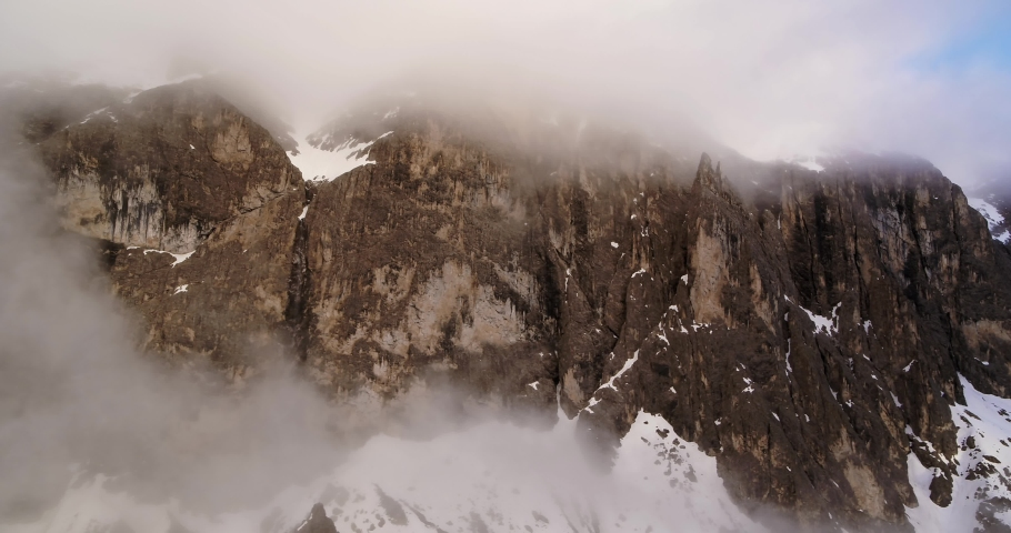 Rock face after rainy day in the Alps. Aerial of beautiful Dolomites mountains   Shutterstock HD Video #1055651966