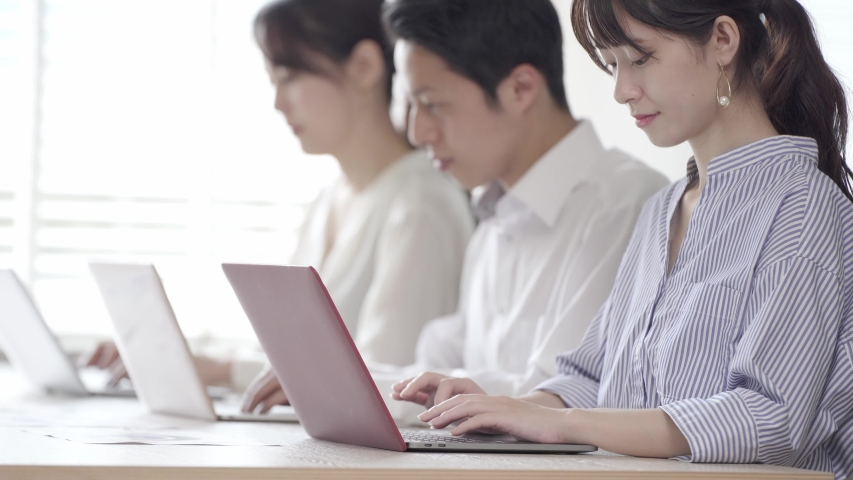 Asian businesspeople using laptops at office | Shutterstock HD Video #1055654066