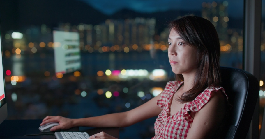 Woman work on computer at night | Shutterstock HD Video #1055657729