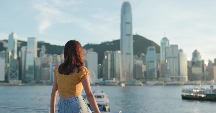 Woman look at the city in Hong Kong | Shutterstock HD Video #1055657738