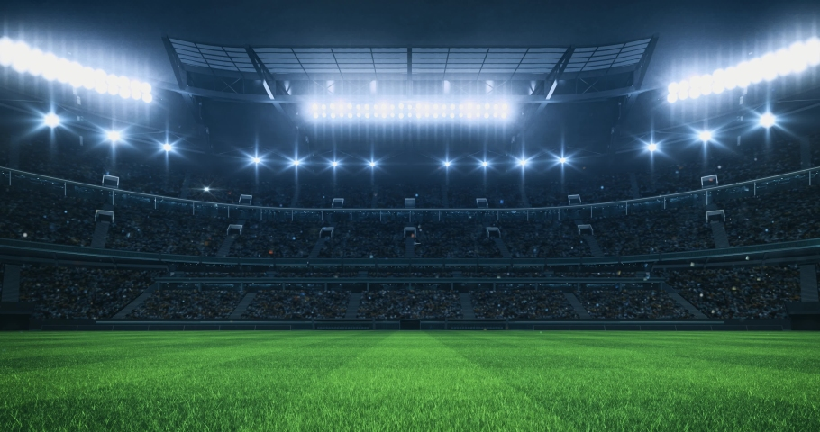 Sports Video background with a stadium full of fans, grass pitch and with spotlights on. Sport building 4k loop animation.