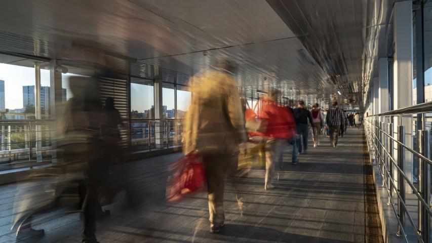 Pedestrian motion along transparent bridge ,time lapse | Shutterstock HD Video #1055701487