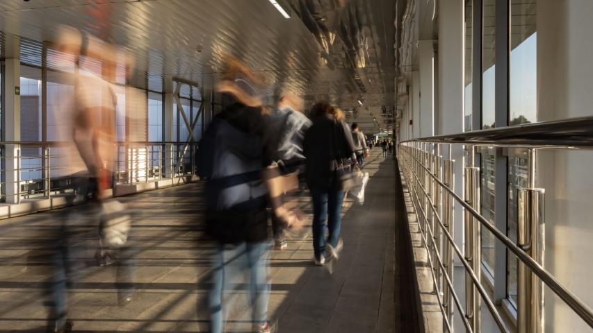 Pedestrian motion along transparent bridge ,time lapse | Shutterstock HD Video #1055701490