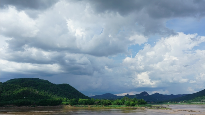 Time lapse Panorama view River on the background mountains landscape blue sky clouds moving fast. | Shutterstock HD Video #1055701712