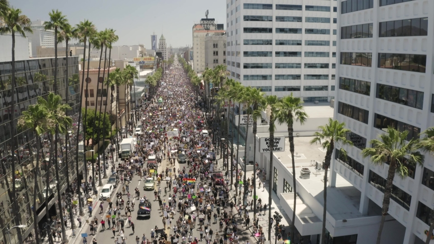 Los Angeles , California / United States - 06 14 2020: Massive All Black Lives Matter Protesting March, Hollywood Boulevard. Tilt Up Aerial View of People With LGBTQ Community Asking For Equal Human C