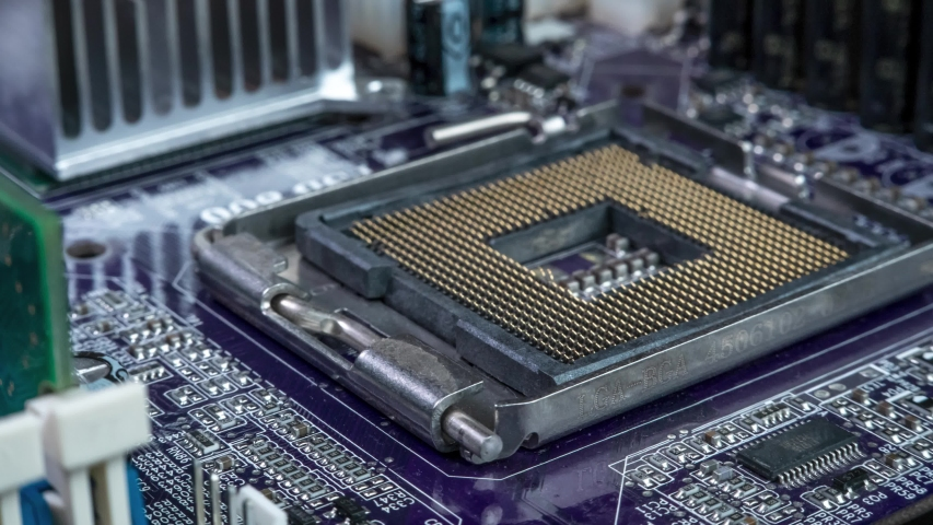 Circuit board background of PC computer motherboard. Computer circuit board close up, electronic technology background Royalty-Free Stock Footage #1055775710