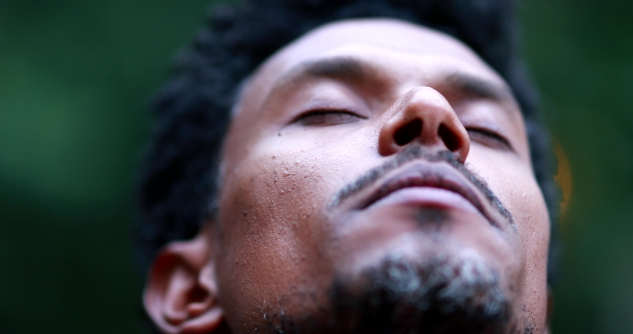 African man face close-up opening eyes to the sky smiling | Shutterstock HD Video #1055780288