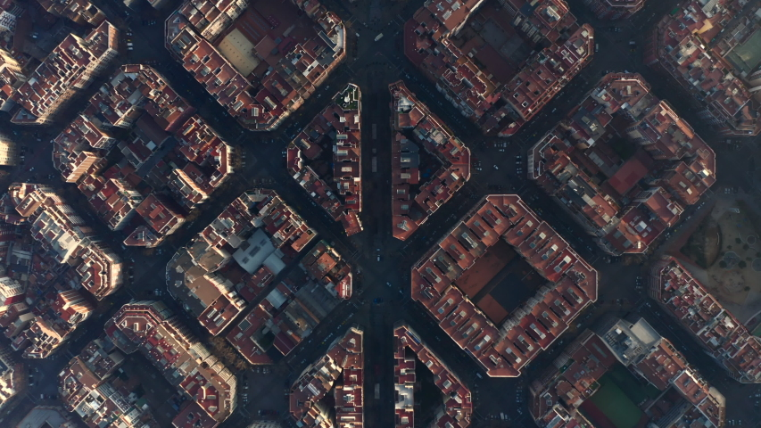 AERIAL: Barcelona Overhead Drone Shot of Typical City Blocks in Beautiful Sunlight with Urban Traffic [4K] Royalty-Free Stock Footage #1055789519