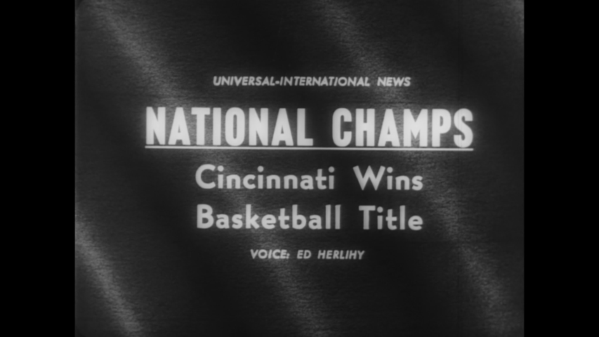 CIRCA 1962 - The Cincinnati Bearcats play the Ohio State Buckeyes in the NCAA championships, held in Louisville's Freedom Hall.