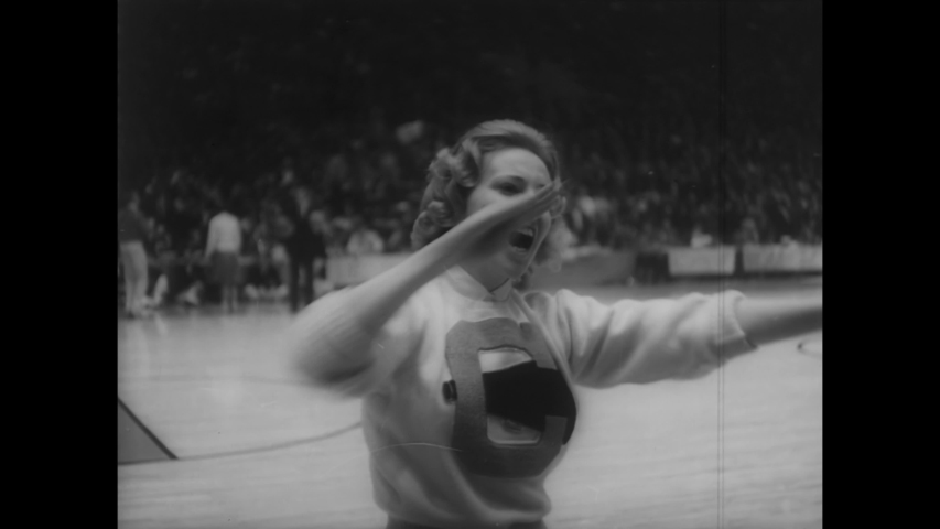 CIRCA 1962 - The Cincinnati Bearcats defeat the Ohio State Buckeyes in the NCAA championships, held in Louisville's Freedom Hall.