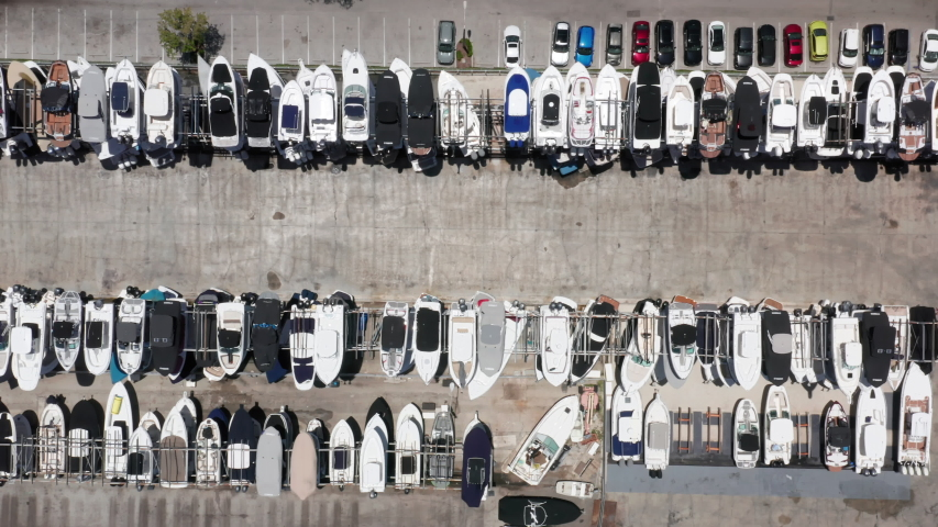 4K aerial water sport and transportation. Top-down view on straight rows of multi-level yacht parking at the sailing club. Beautiful slow motion drone video for yacht business. Marine club, Florida | Shutterstock HD Video #1055845490