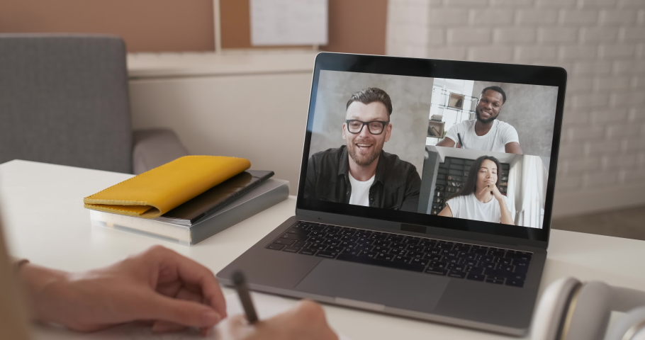 Discussing project online. Multi-ethnic group video call. Remote communication of happy multiracial young people. Working from home office during pandemic. Webcam view. Business chat conference | Shutterstock HD Video #1055858015
